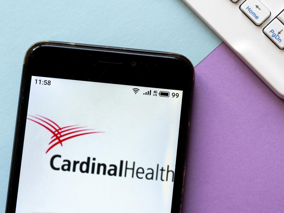 In this photo illustration a Cardinal Health logo seen...