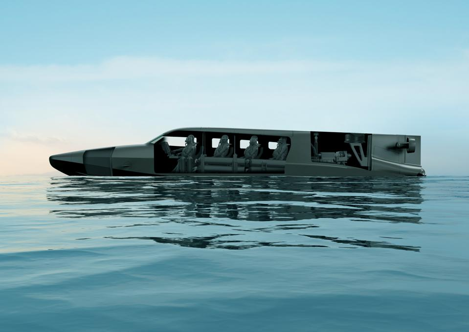 Divers sit inside the Victa submarine by SubSea Craft
