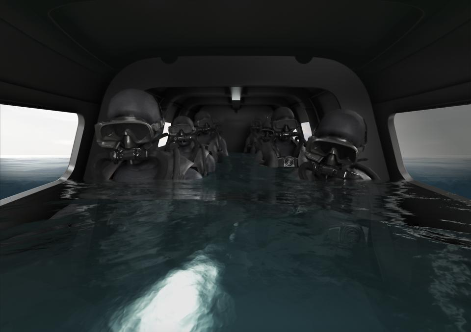 Divers inside the Victa submarine by Subsea Craft