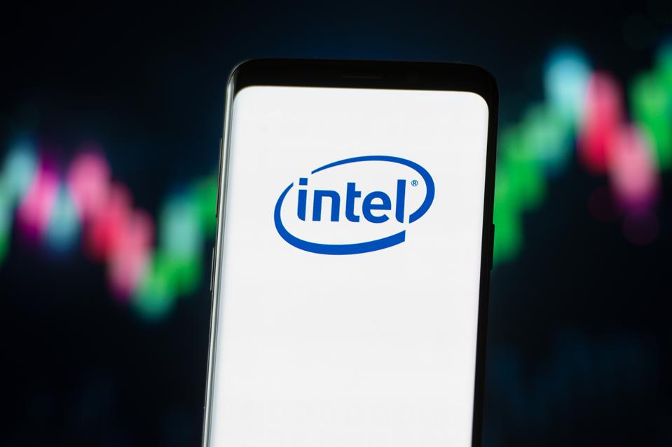 In this photo illustration an Intel logo seen displayed on a...