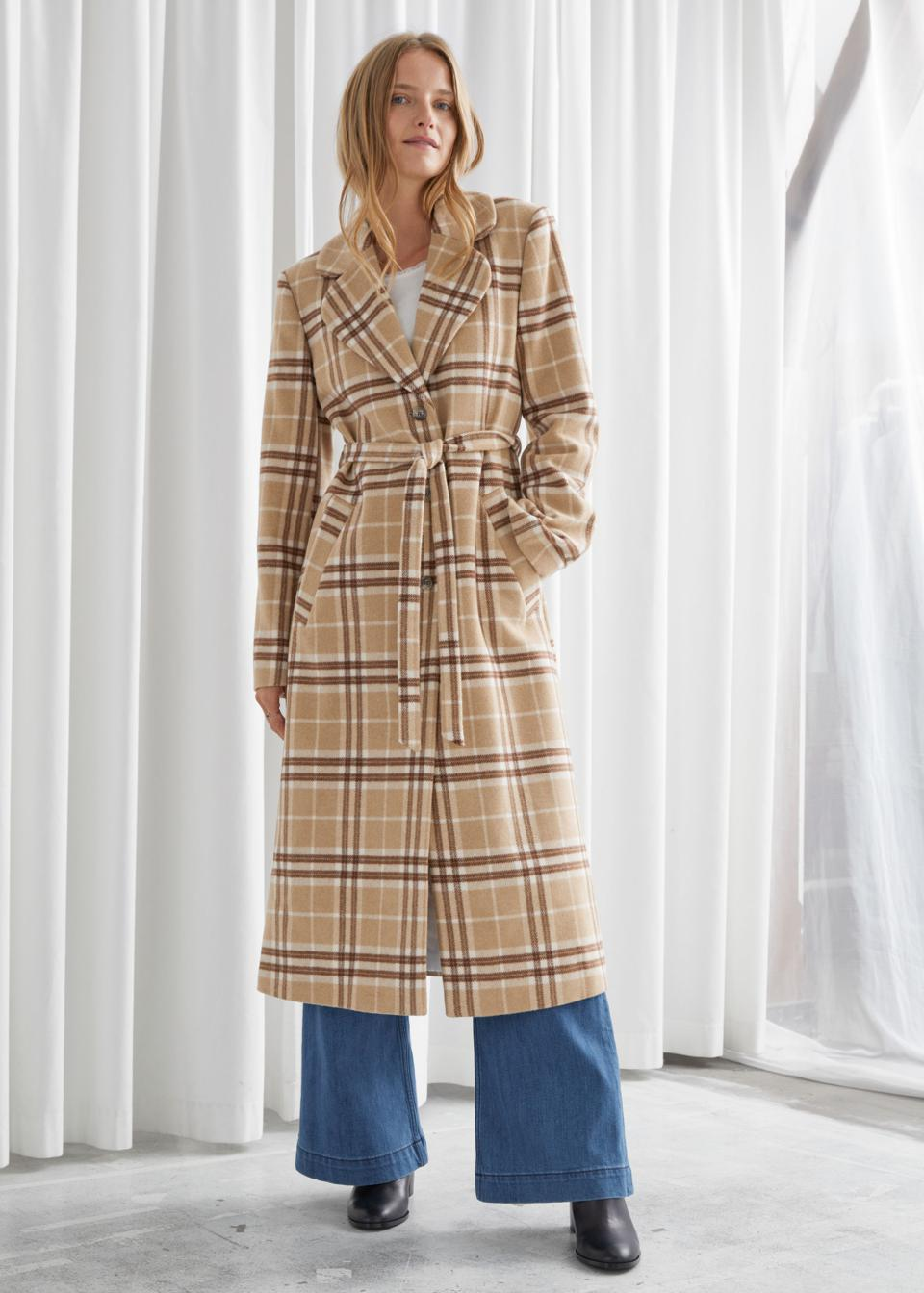 Woven plaid wool blend coat accentuated by a tonal self-tie belt