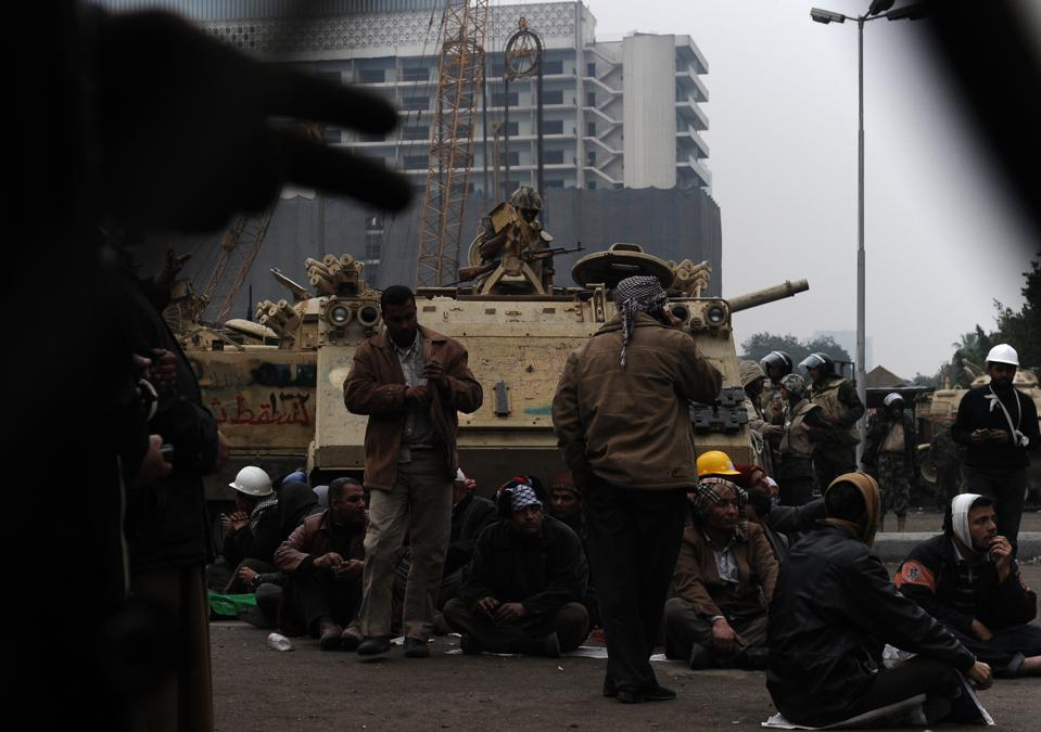 Egyptian anti-government protesters sit