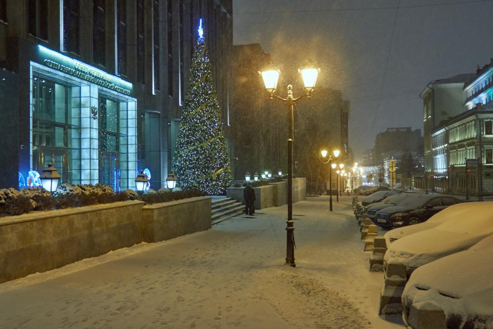 Night snowfall in the city centre