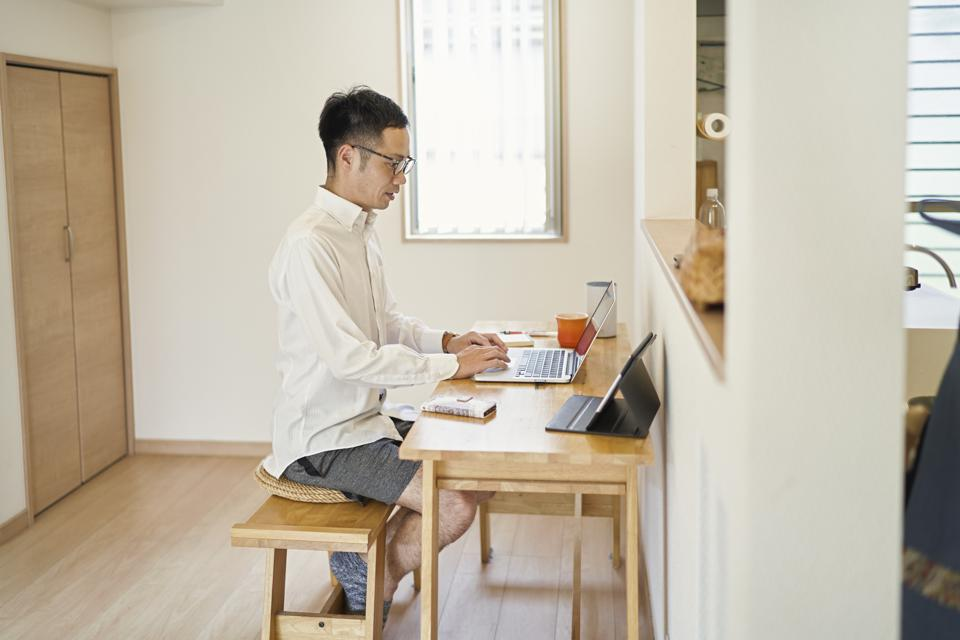Man working from home in a makeshift office in the living room