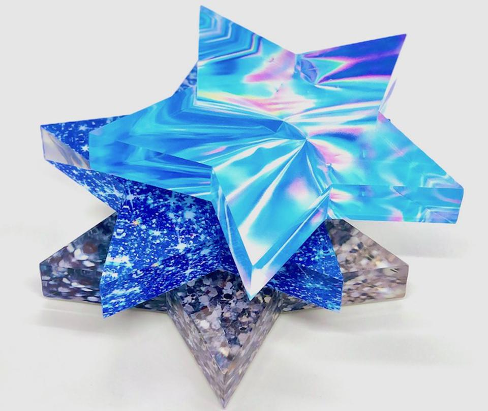 Star shaped blue and metallic paperweights