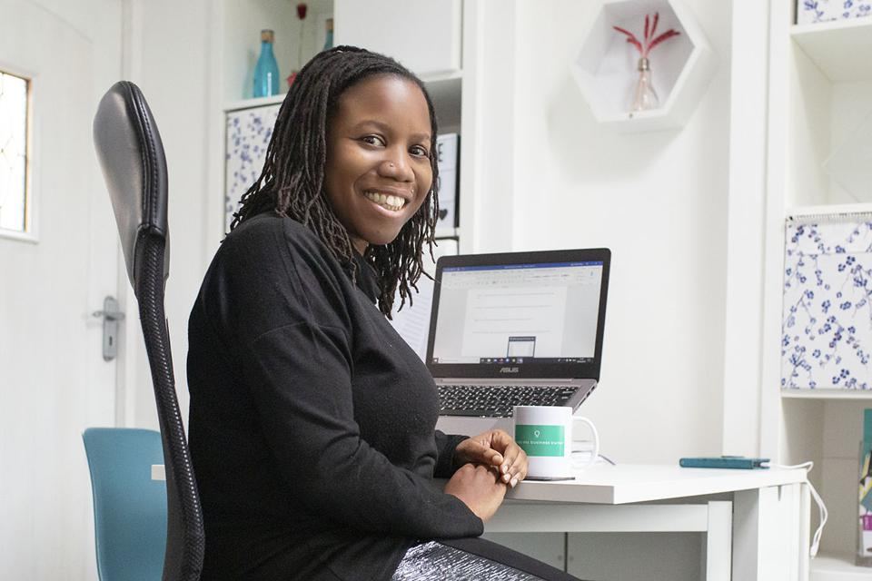 Collette Philip Managing Director Brand by Me, sitting in an office at a desk