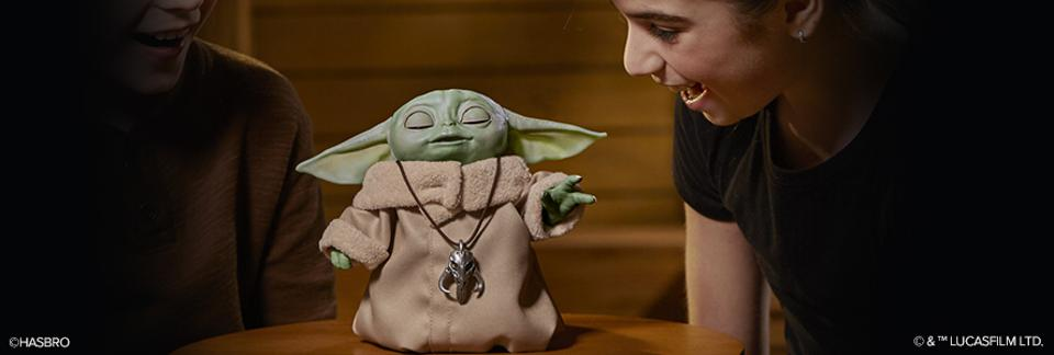 The Child Baby Yoda toy from Star Wars The Mandalorian