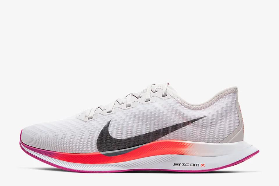 White Nike Zoom Pegasus Turbo 2's with red and pink detailing.