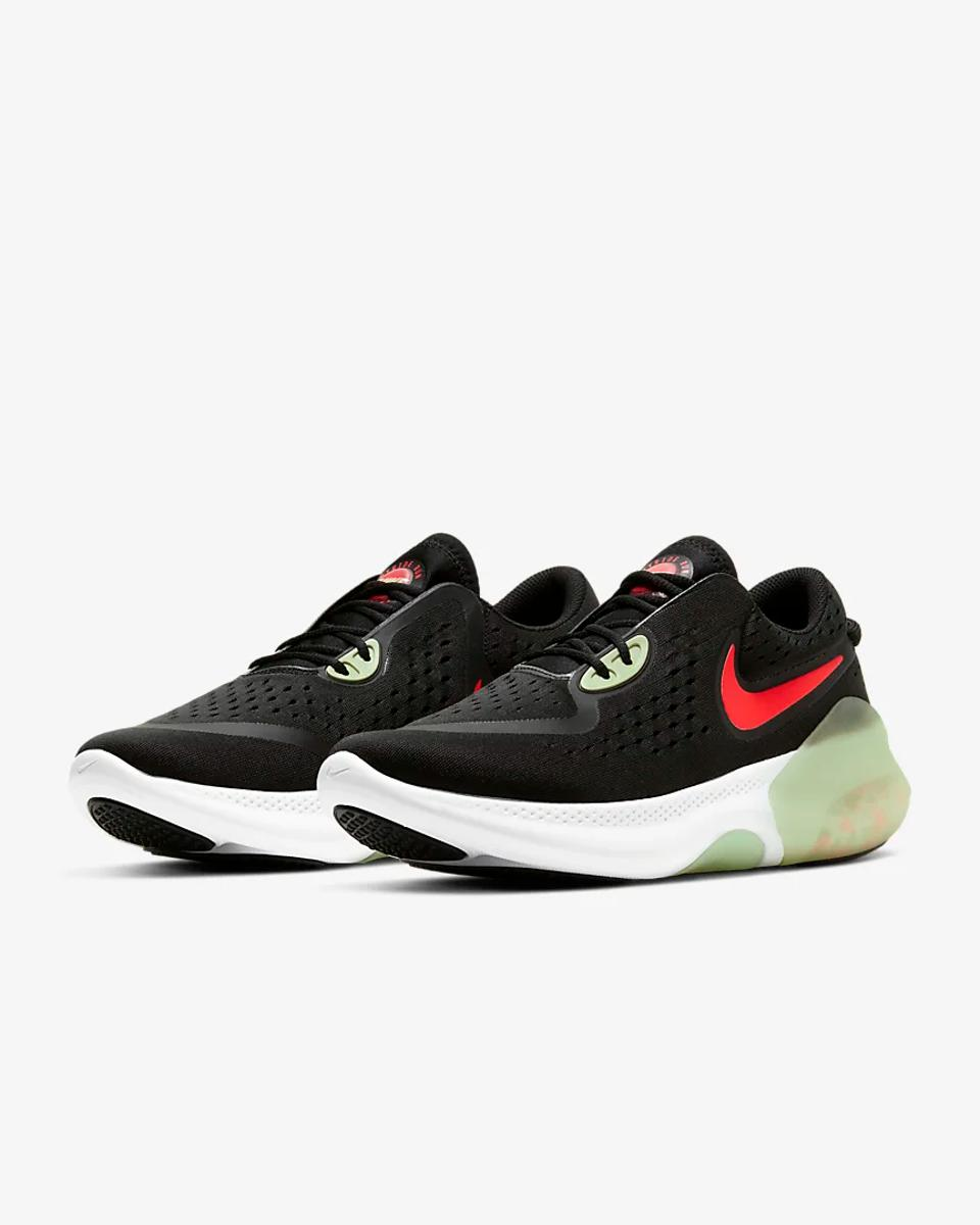 Nike Joyride Dual Run in black with a red Nike swoosh and green lower detailing.