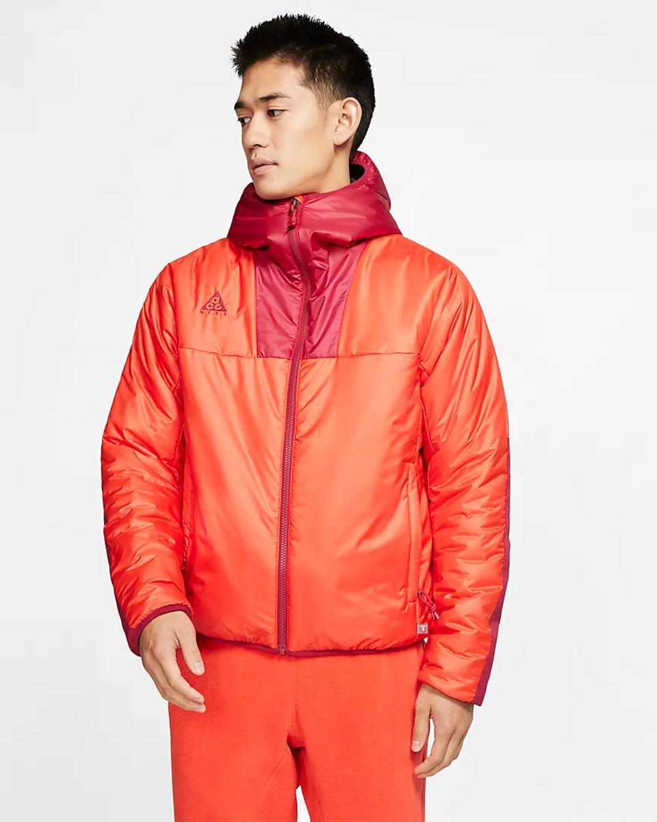 Orange Nike ACG PrimaLoft hooded jacket.