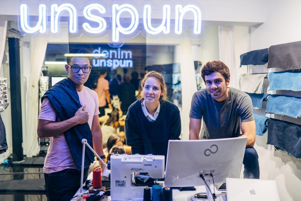 Unspun jeans store with team members