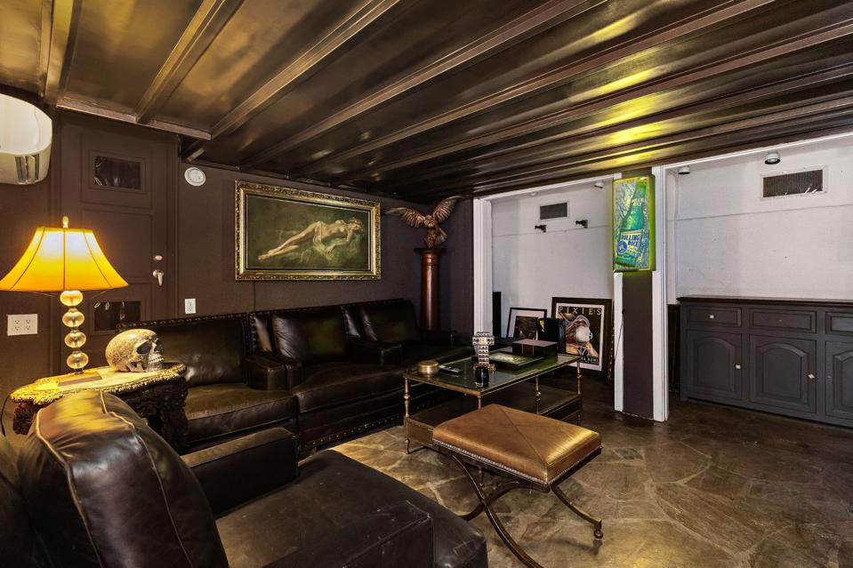 A subdued basement with black walls and ceilings.