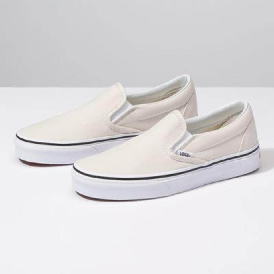 White Vans slip-ons.