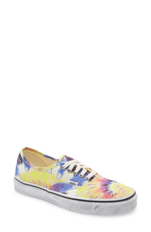 Tie-dye Vans lace-up sneakers.