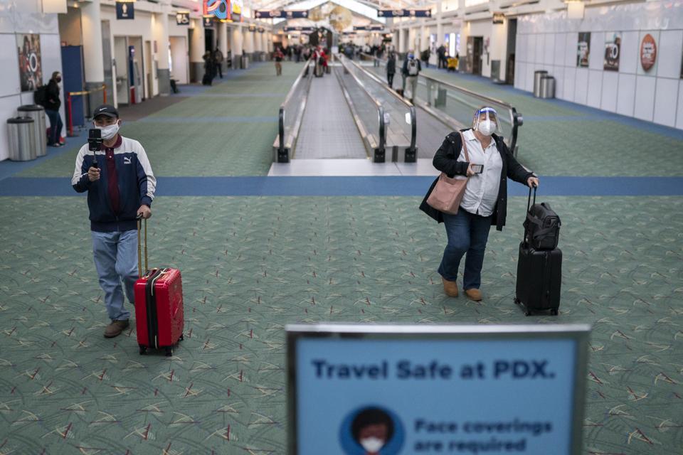 Travelers walk through Portland International Airport on November 25, 2020 in Portland, Oregon.