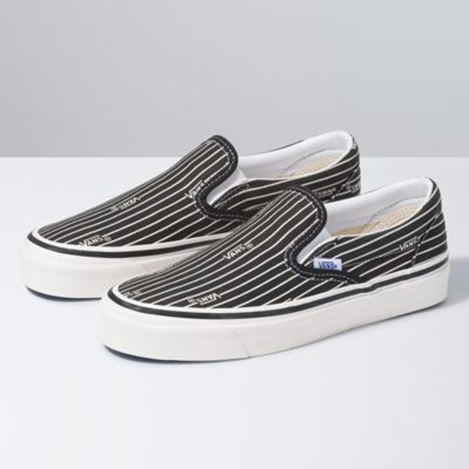 Pinstripe slip-on Vans in black and white.