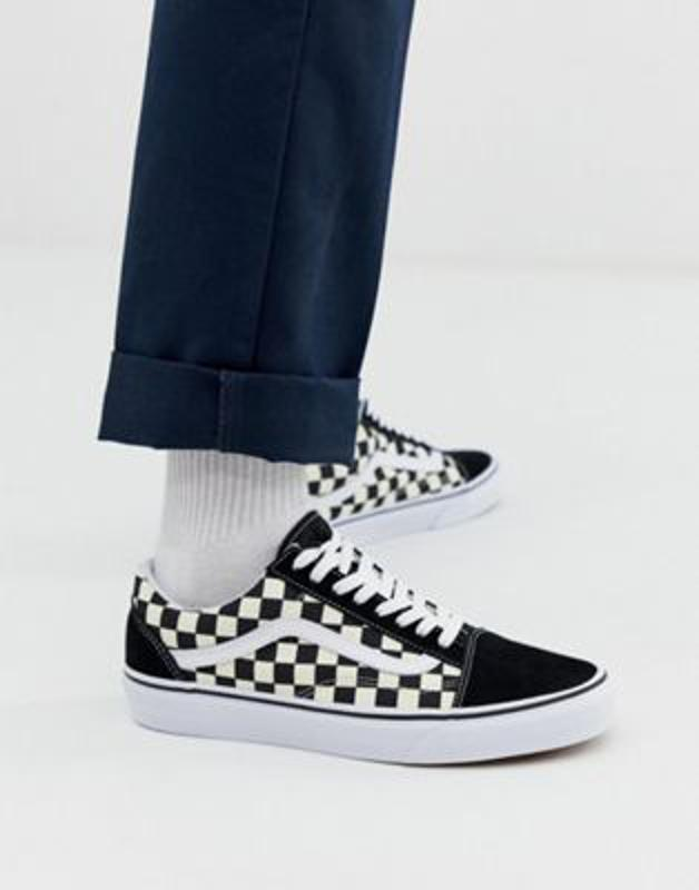 Checkerboard black and white lace up vans.