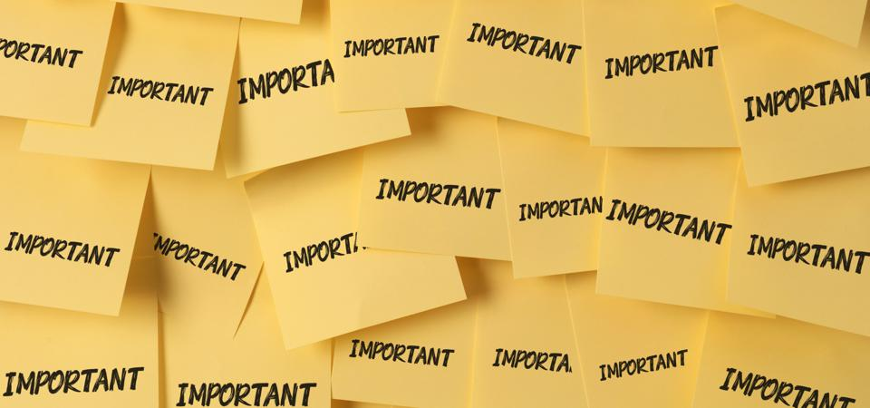 Overlapping yellow post-it notes each with Important written in black