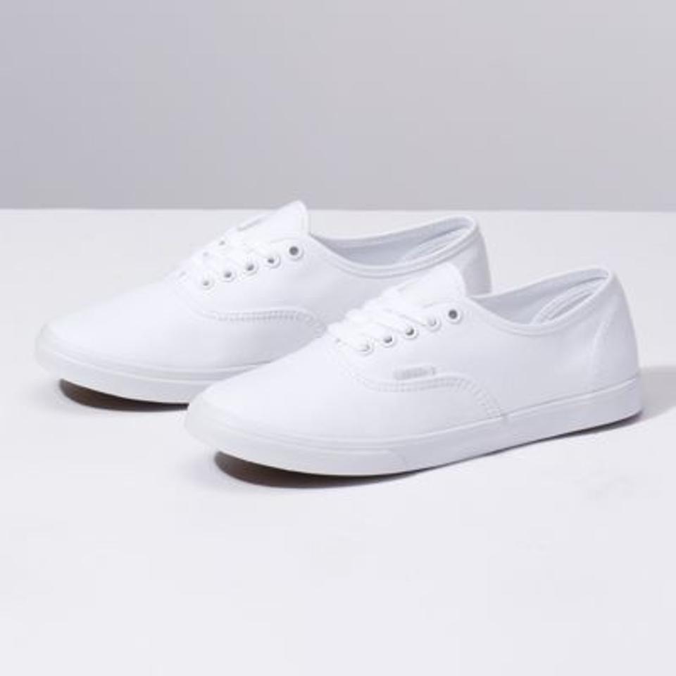 White lace-up Vans.