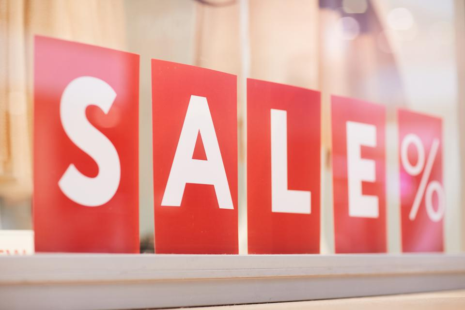 Sale Sign in Clothing Boutique