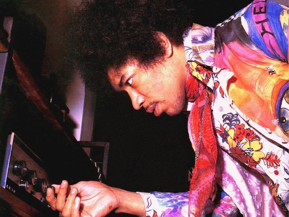 Jimi Hendrix turning up the volume on a LEAK Stereo 30 amplifier