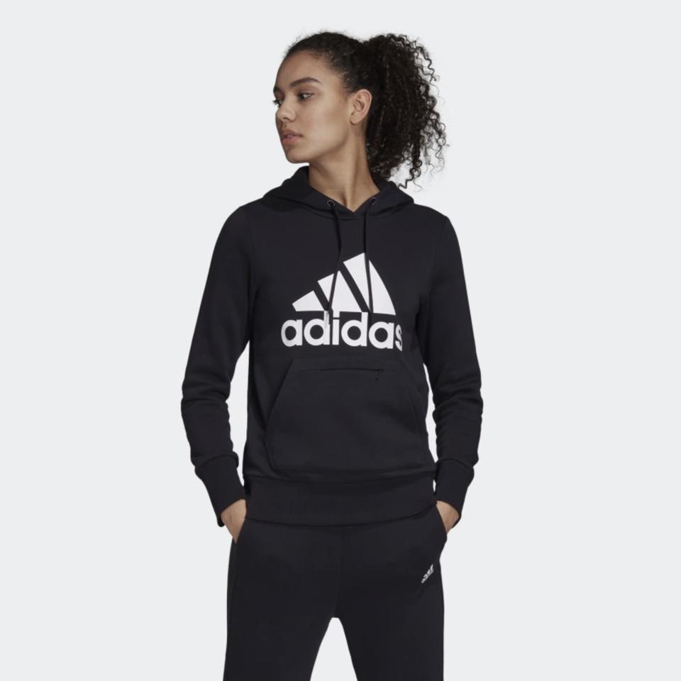 Woman wearing an Adidas Badge of Sport Pullover Fleece Hoodie