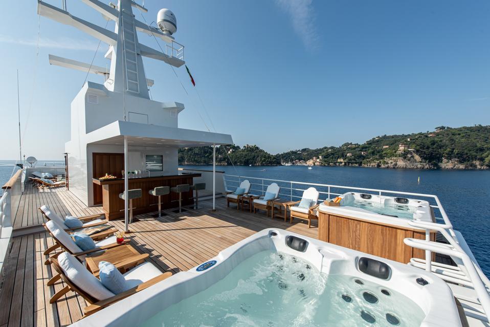 The top deck of the Bleu de Nîmes superyacht, featuring two Jacuzzis