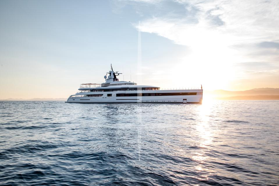 Lady S superyacht sails on the ocean at sunset