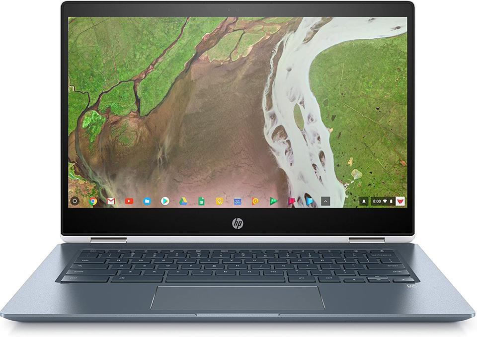 HP Chromebook x360 laptop opened and showing Chrome OS desktop