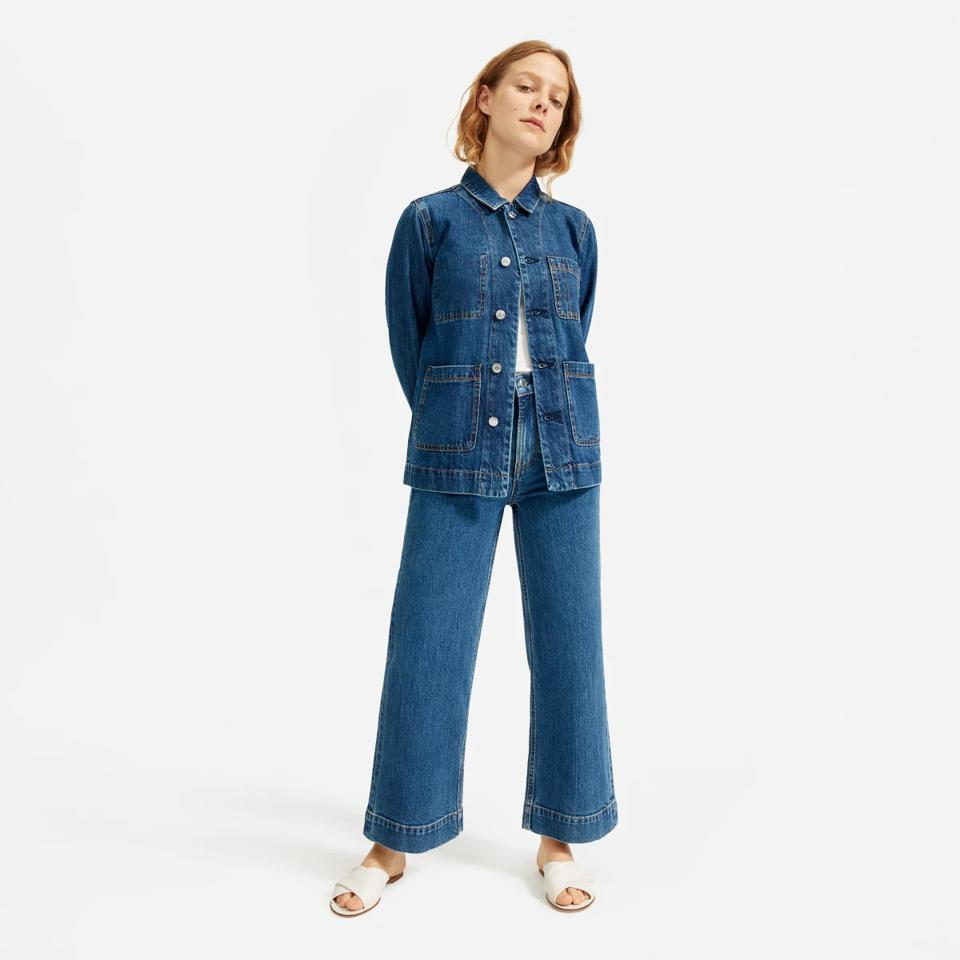 Everlane model in denim jeans and chore coat.