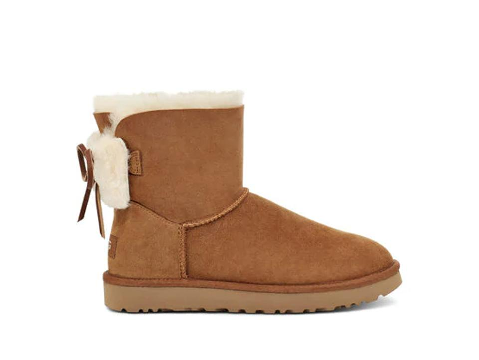 Tan ugg boot with bow detailing.