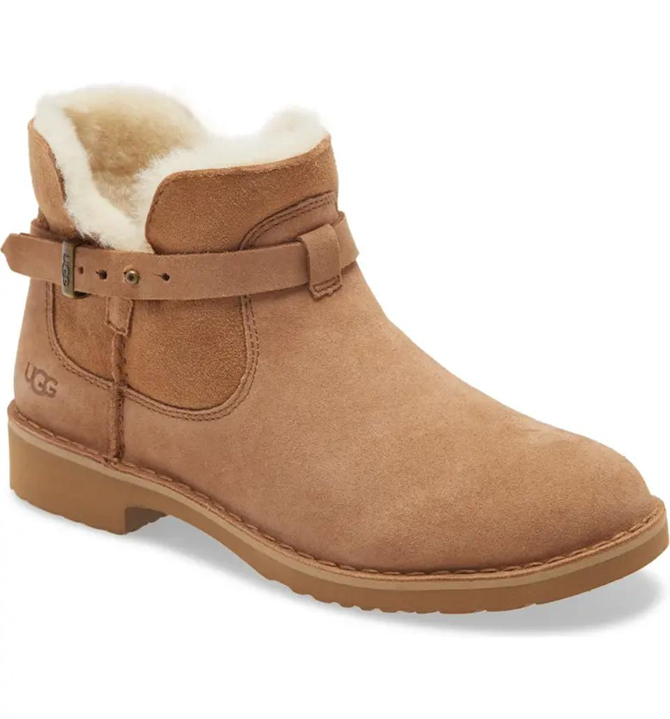 Ugg heeled boot with buckle detail.