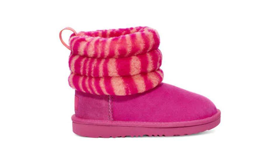 Kids pink fluffy Ugg boot.