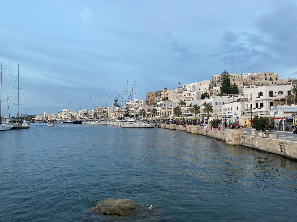 The harbor at Naxos Town is a layer of stone and whitewashed buildings, a common sight in many Greek coastal areas.