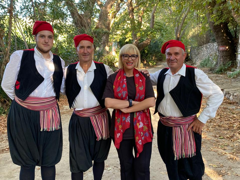 Chef Maria Loi with some Naxian dancers in traditional garb.