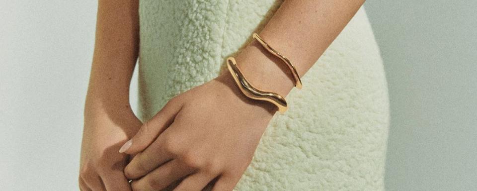 Gold wavy Agmes bracelets.