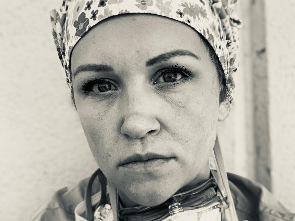 Ashley Bartholomew, a RN in El Paso, takes a break between codes on a COVID-19 unit