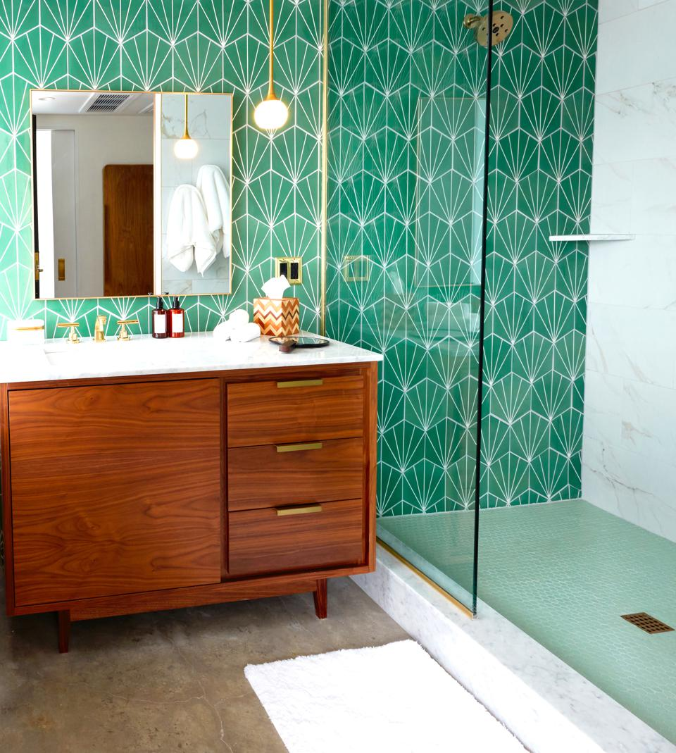 green and gold bathroom with walk-in shower