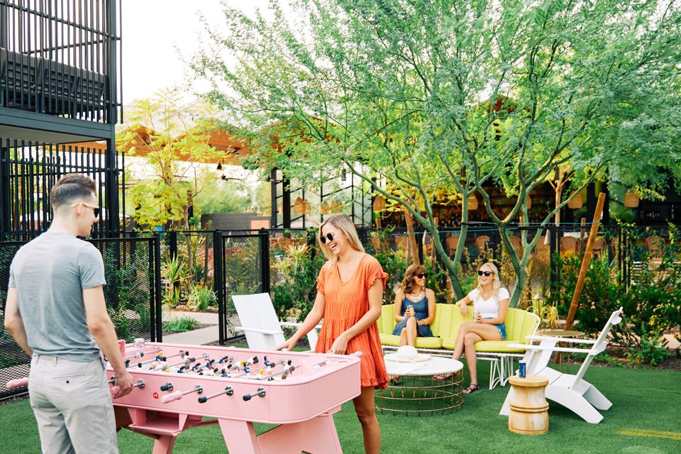 pink foosball table outdoors