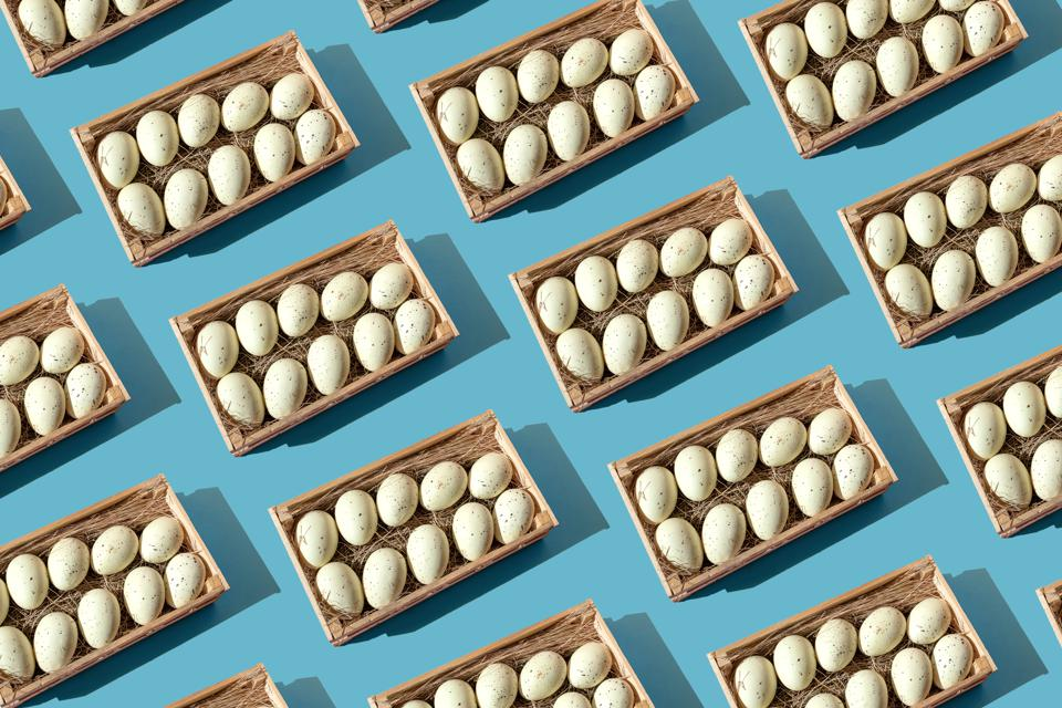 Baskets with animal eggs on the blue background