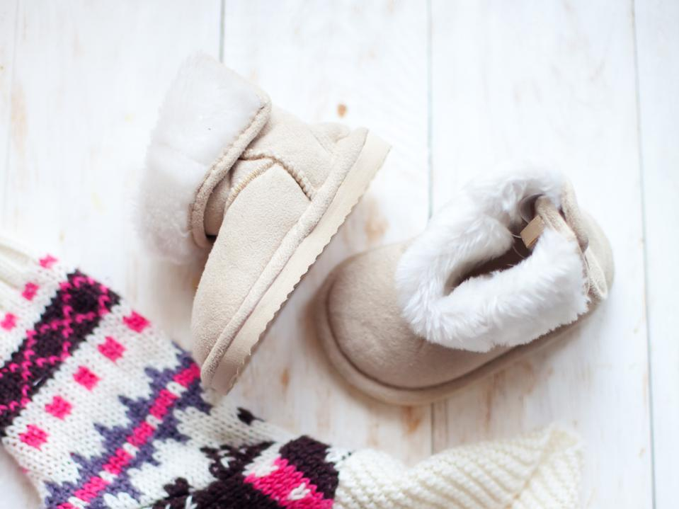 small pair baby ugg on white background