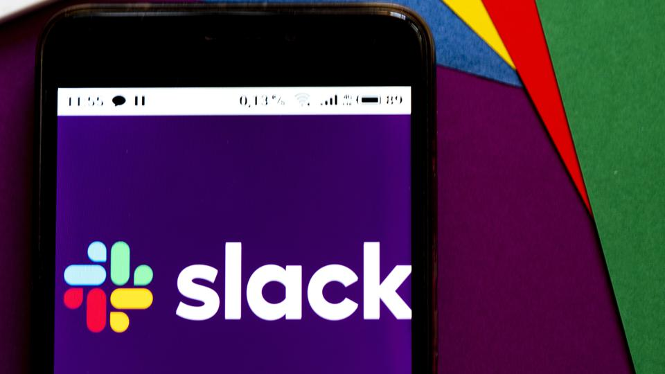 In this photo illustration a Slack logo seen displayed on a...