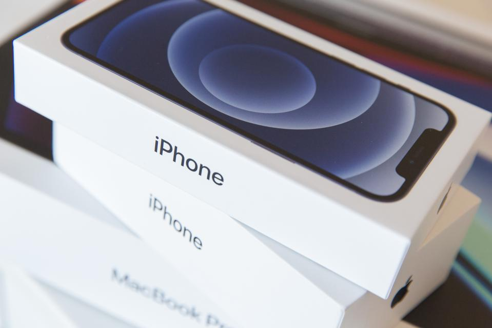 A pile of iPhone 12 boxes - check these 'risky' security settings now