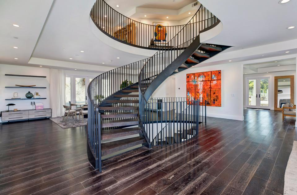 A sweeping staircase extends upward.