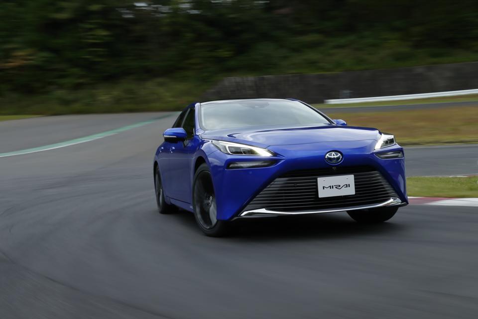 2021 Toyota Mirai driving around a track.
