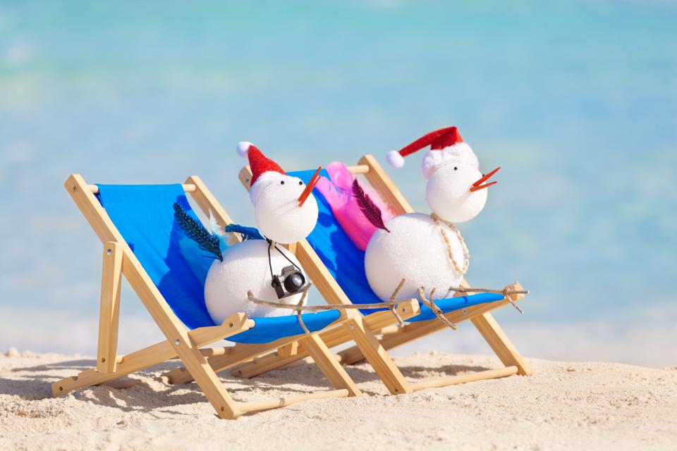 Snowbird Couple Enjoying Tropical Beach Christmas Vacation by Caribbean Sea