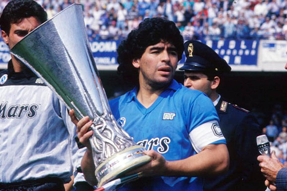 Diego Armando Maradona holds up a trophy in this undated photo in Italy.
