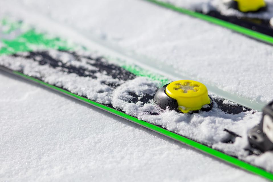 Wearable sensor skiers can attach to their skis to collect data in Bode Miller's SKEO app