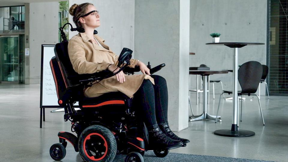A Munevo Drive user using the Google Glass wheelchair steering system