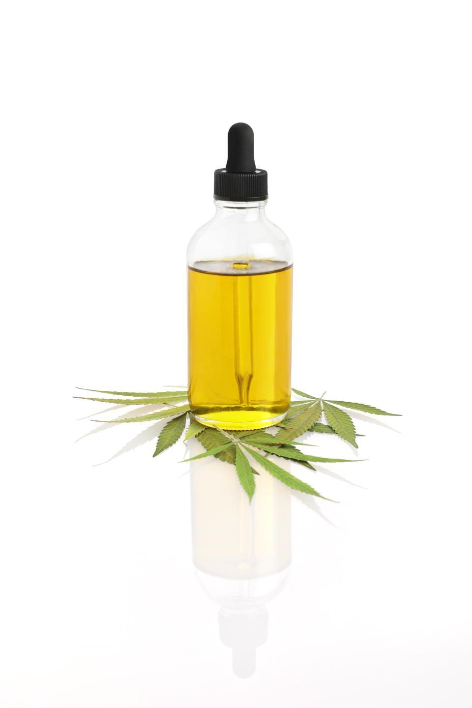 Bottle of CBD Oil with hemp leaf